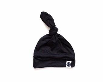 Black top knot beanie