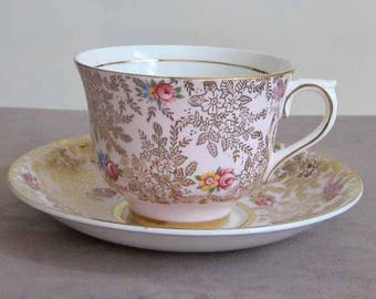 1940's Fine Bone China Teacup and Saucer by English Maker Colclough in Light Pink with Gold Gilt