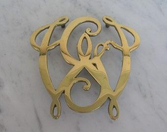 1976 Bicentennial George Washington cypher brass trivet by Virginia Metal Crafters