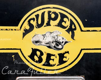 Super Bee Emblem on Yellow Dodge Photograph