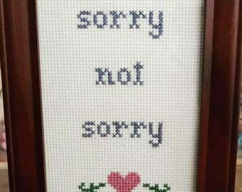 Sorry Not Sorry Funny Cross Stitch Framed!  Decorate your place with very inappropriate fun!