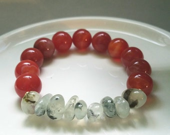 Soulnite.  Stretch bracelet. Carnelian beads with prehnite and 14k goldfilled accent beads
