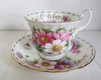 Vintage royal albert october bone China england. Flower of the month series ' Cosmos '. Coffee Cup and saucer with gold edge.