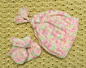 Hand-crocheted baby sack hat with tassel and matching booties