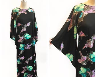 Dramatic watercolour floral print 1970's dress with batwing sleeves. Size M.