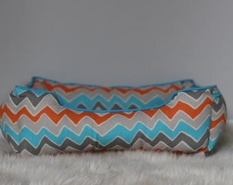 Handcrafted dog or cat bed. Made for your best friend. Style: Aqua and Orange Zig Zag