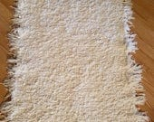 """RESERVED for William.....Cream handwoven rug.  27"""" x 51"""" plus fringe.  Add texture and comfort to your home.  Works with any decor."""