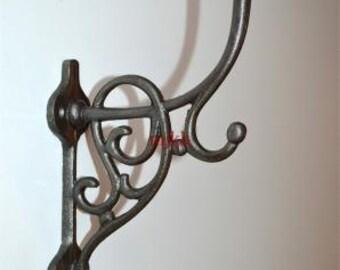 A large Art Nouveau style triple cast iron coat hook AL43