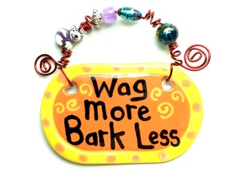 Wag more Bark Less #505 orange ceramic sign
