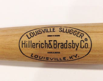 Vintage souvenier baseball bat louisville slugger minature