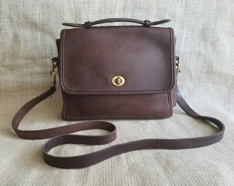 Vintage Coach Court top handle crossbody bag in Chocolate Dark Brown Leather with hangtag brass buckles turn lock closure/ serial 9870
