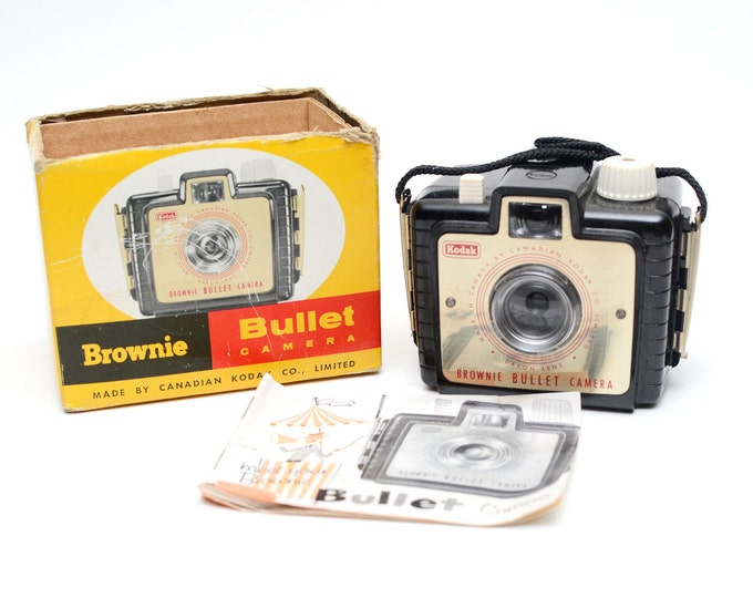 Featured listing image: Vintage Brownie Bullet Canadian Kodak Box Camera For 127 Film Format with box and manual