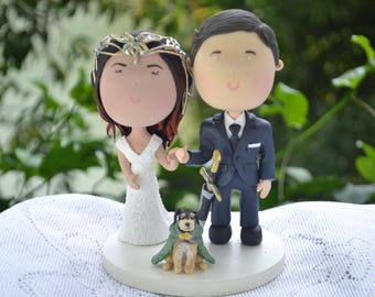 Couple holding hands with pet - Arwen and Aragon. Wedding cake topper. Handmade. Fully customizable. Themed Wedding