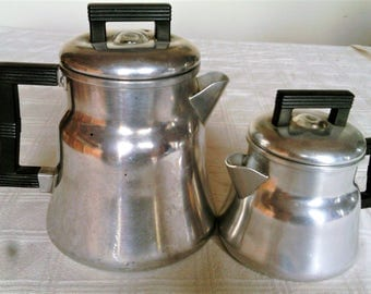 A pair of Vintage Stovetop Aluminum Coffee Pots With Bakelite Handles-Six And Two Cup Pots