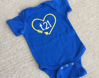 "Down Syndrome Awareness Onesies ~ Baby Girls or Baby Boys, Royal Blue Short-Sleeved Onesie with Yellow and White ""T21"" Logo and Arrow Heart"