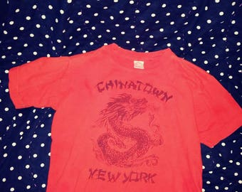 1990s Vintage Children's  (fits small woman)Large Chinatown New York tshirt orange with black graphic