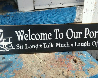 Welcome to our porch with rocker, stenciled wood sign