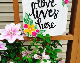Love lives here: Wooden sign