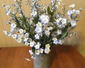 Blue Forget Me Knot sill floral arrangement