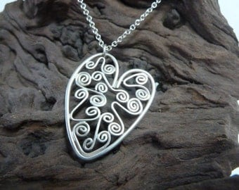 Heart shaped silver pendant