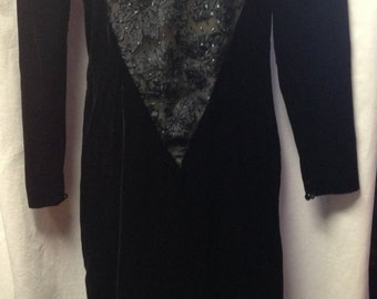 1980s Black Velvet Dress made by Niki in size 4.  It has a v-shaped back with a bow.  Great for formal events.