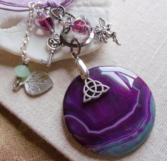 Round purple Necklace - pendant  charm -  lilac ribbon - stone necklace -  Celtic- key - fairy charms -  U2 memento - silver leaf - irish