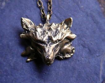 Wolf, solid brass locket