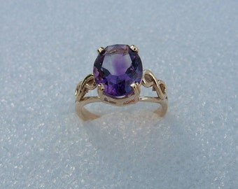 Gold and Amethyst ring=Oval shaped Amethyst set in yellow gold ring with eternity symbols on each side-Amethyst ring