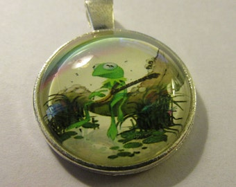 Silver Tone Glass Dome Pendant of Green Frog with Banjo, 1""
