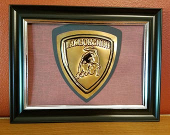 Handmade Embossed Lamborghini sign made from a recycled soda can.