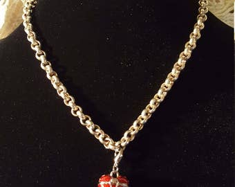 RED HEART LOCKET - on a very heavy/thick silver chain - very nice!  Great Gift Idea :)