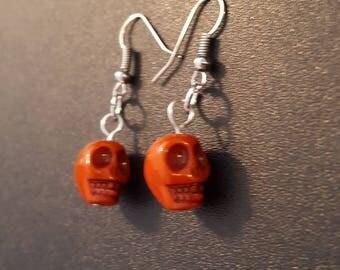 Orange acrylic skull beaded drop dangle earrings with silver detail