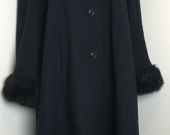 Vintage oversized black wool coat with faux fur hood and cuffs