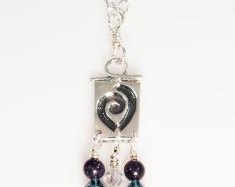 Sterling Silver Koru necklace with Swarovski crystals and blue sunstone beads