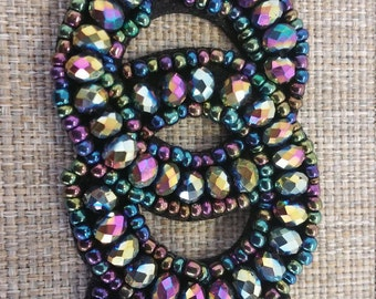 Round beaded applique with different colors