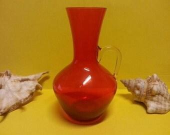 Vintage orange glass jug / vase with clear glass handle