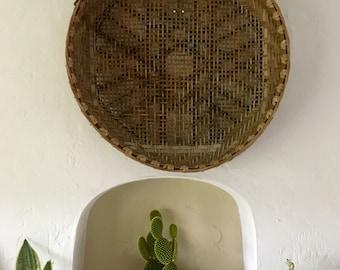 Vintage wicker basket wall hanging