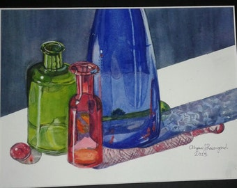 Three Glass Bottle and a Marble