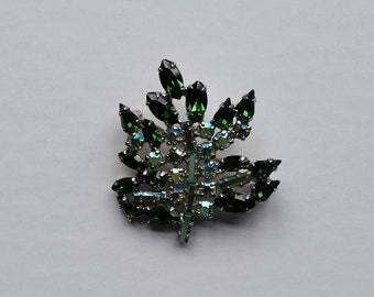 Vintage B. David brooch with green and clear rhinestones