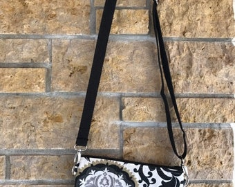 Purses with adjustable and interchangeable strap.