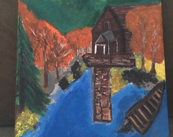 Cabin and lake painting