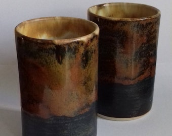 a set of bronze and black tumblers