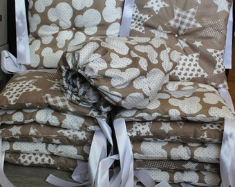 A set of cushions in the cot