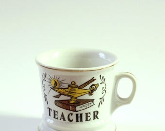 heavy vintage teacher mug with oil lamp and book, limoges mug