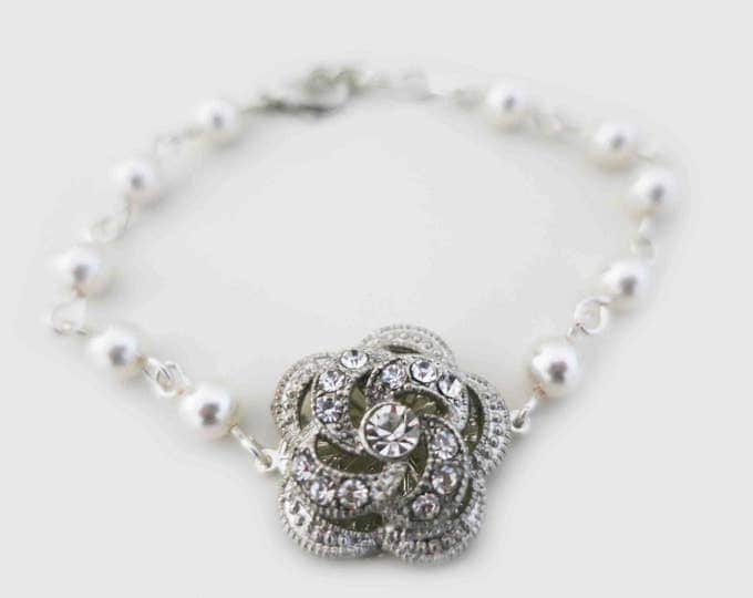 Vintage Styled ivory pearl bracelet with a rose brooch