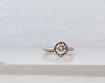 Women's unique engagement ring, facet textured setting with peekaboo setting, recycled gold and moissanite engagement ring with open bezel