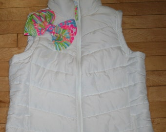Ladies white or navy puffer vest trimmed with a Lilly Pulitzer fabric bow