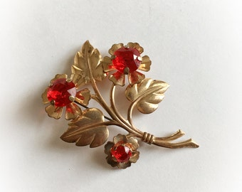 Vintage Gold Tone Metal Flower Brooch with Large Red Rhinestone Centers