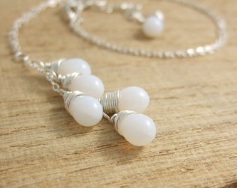 Necklace with a Cascade of Milky White Glass Teardrops on a Sterling Silver Chain CDN-696