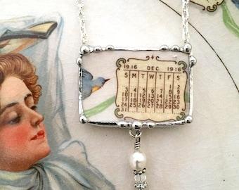 Bluebird china broken china jewelry necklace antique 1916 calendar plate December 1916 bluebird pearl and crystal drop
